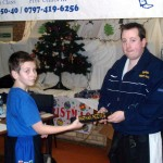 Nathan Recieving his Black Belt December 2004
