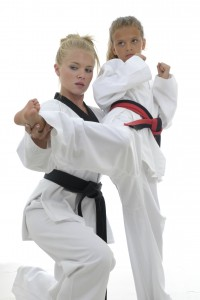 Martial arts instructor guiding a student.